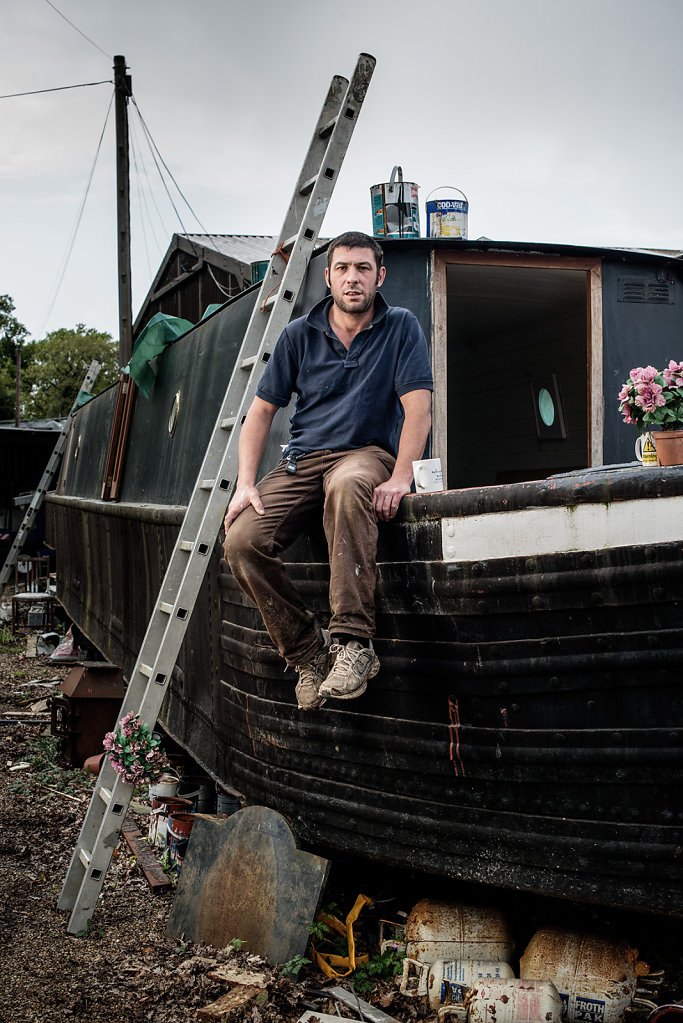 Mark Parker photographed with his barge in Betchworth